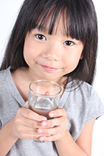 Image of a child drinking water.