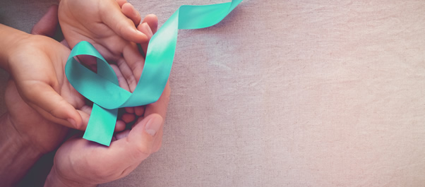 hands holding cervical awareness ribbon