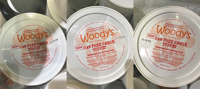 Pictures of Woody's pet food containers